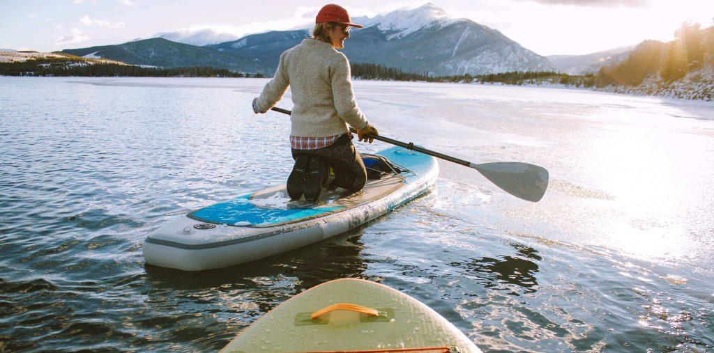 girl standing in kayak