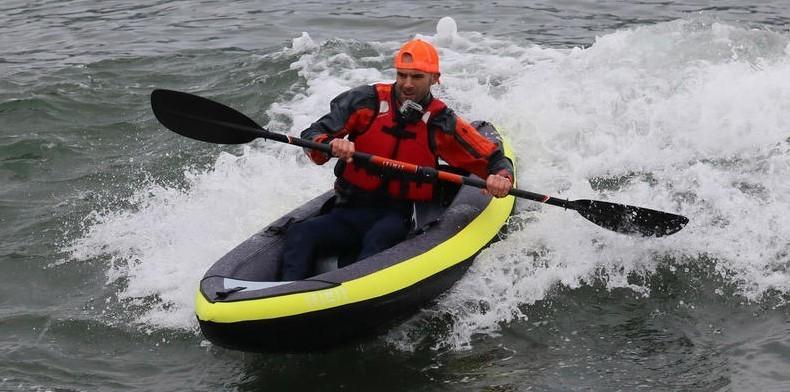 man in inflatable kayak