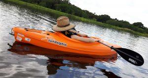 man relaxing in kayak
