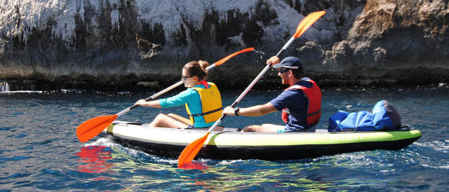 two people in inflatable kayak