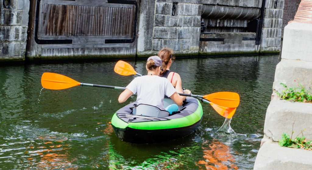 two persons in kayak