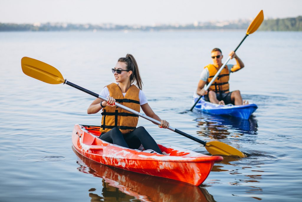 Couple together kayaking on the river