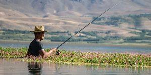 man fishing in fishing hat