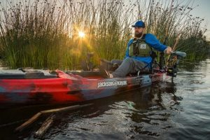 man in trolling motor kayak