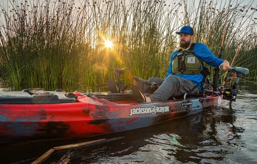 man kayaking with trolling motor for kayak