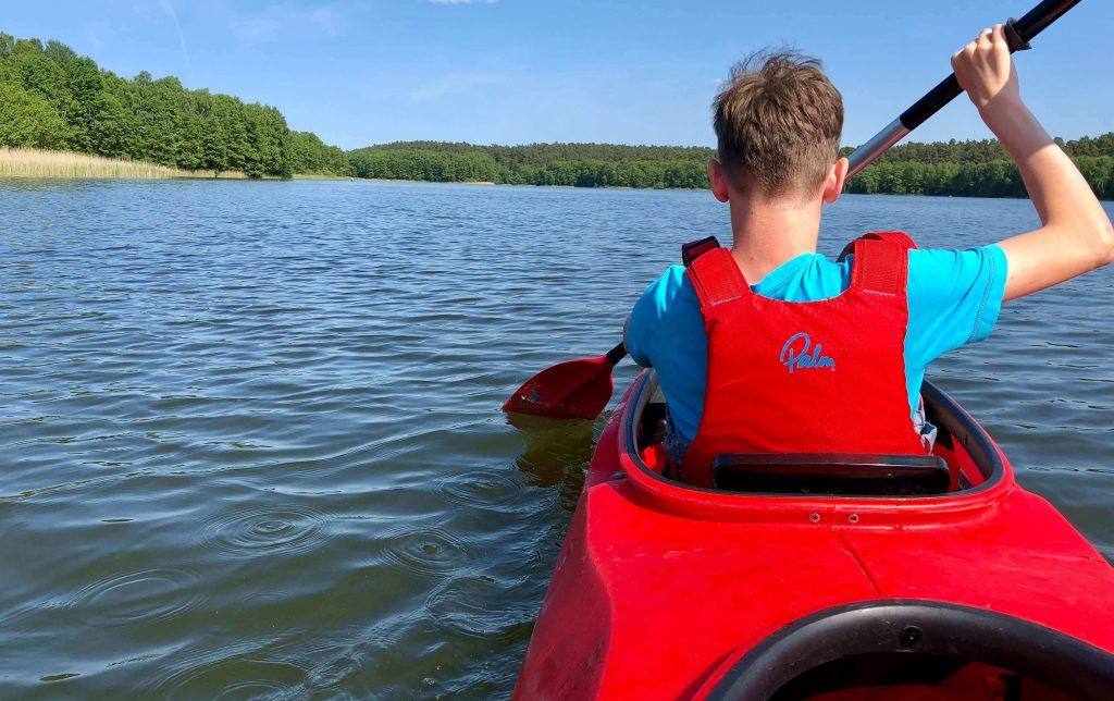 boy in a kayak