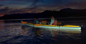 kayaks with lights on water