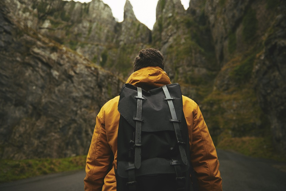 man with a waterproof backpack
